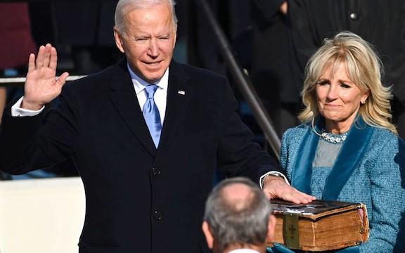 President Joe Biden taking the oath of office with First Lady Dr. Jill Biden