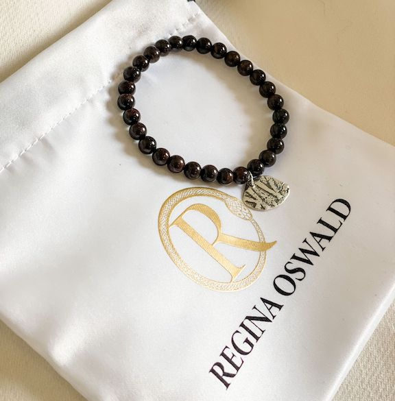 The bracelet is set with a sterling silver charm molded from an authentic ancient Armenian coin