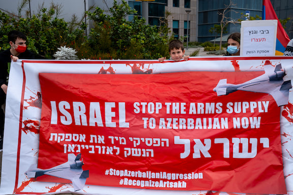 View Gallery: Activists in Tel Aviv protest Israel's arms sales to Azerbaijan (Photos by Yoav Loeff)