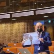 "Armenian lawmaker Edmon Marukyan shows a picture from Aiyev's ""Military Trophy Park"" in Baku during a PACE session on April 19"